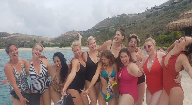 Female sales coach Jade Jemma on Necker Island having fun at the beach