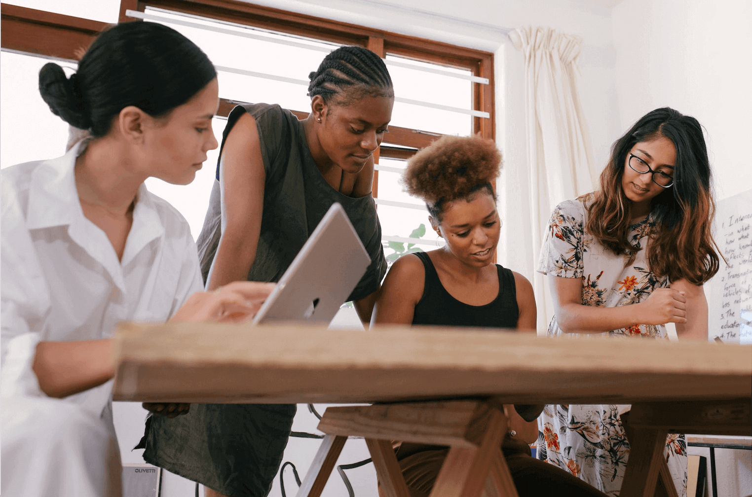 women in business talking around a table