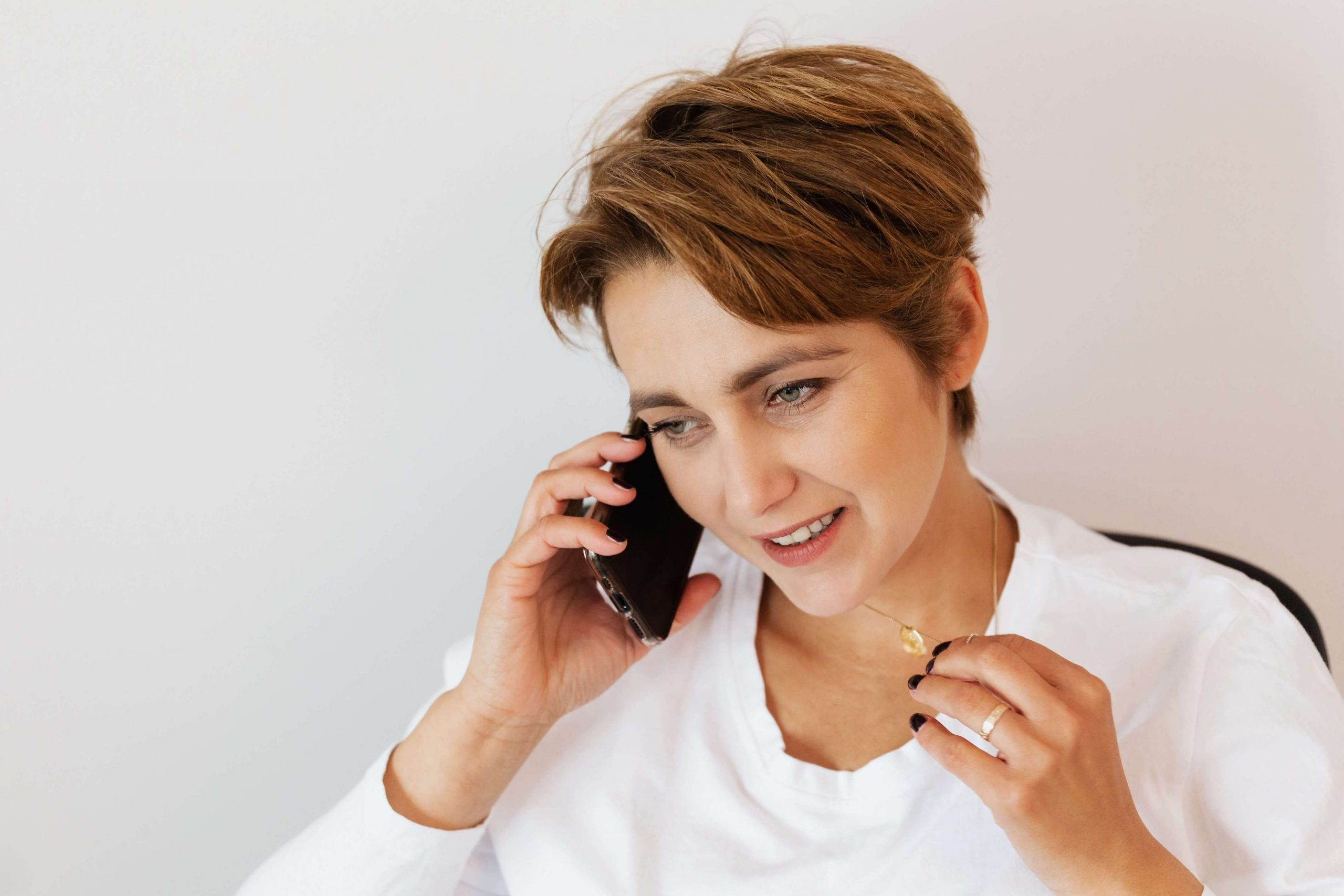 Woman on phone reading sales calls script