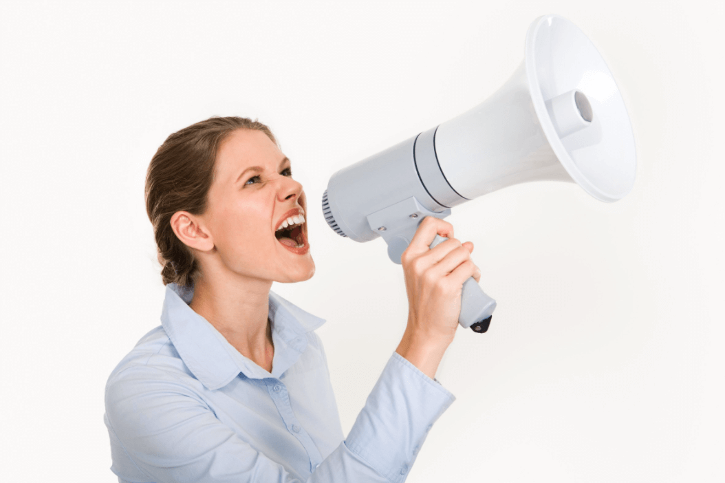 women on megaphone shouting how to be a good leader