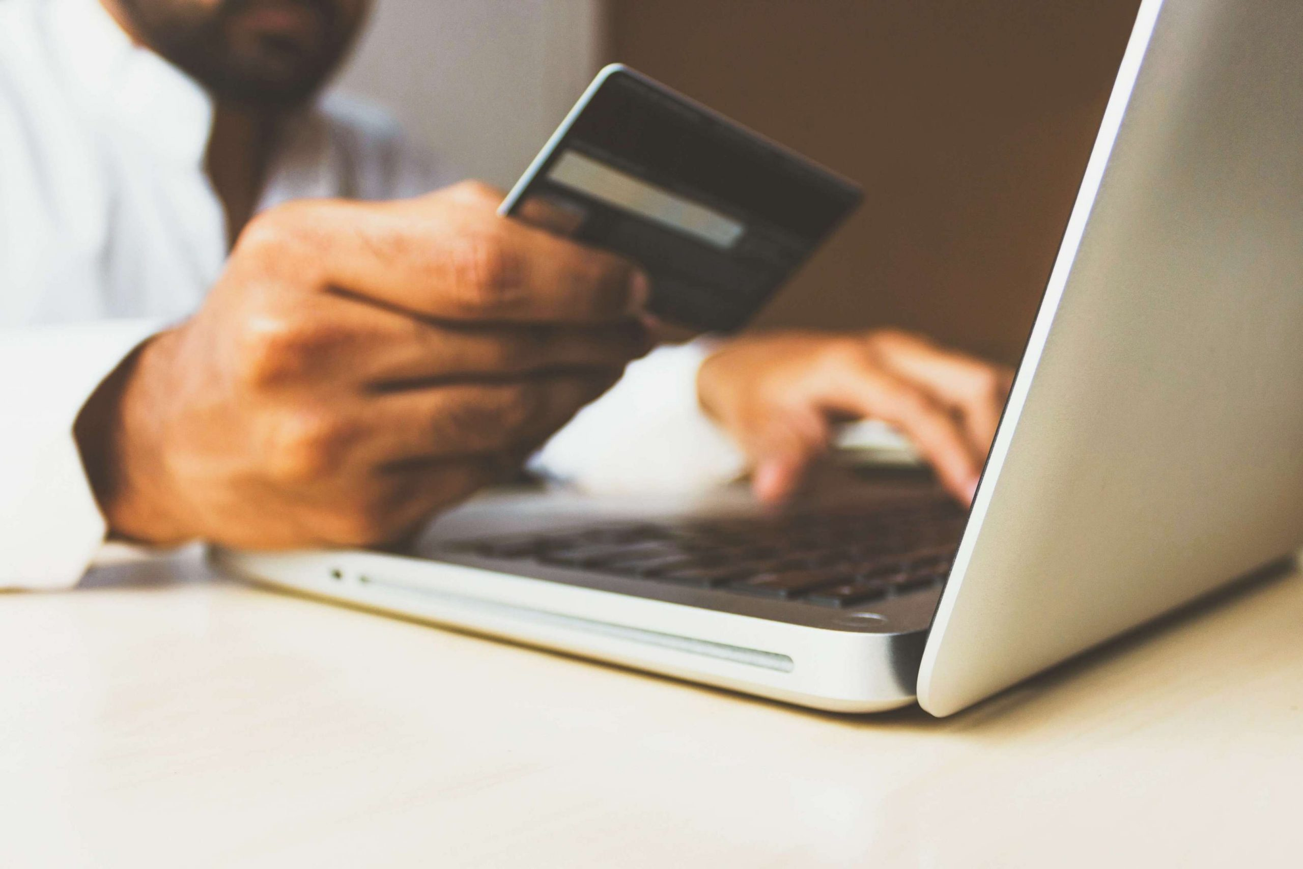 person purchasing online with a credit card - thrivecart review